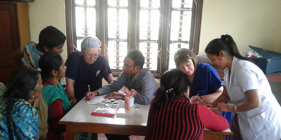 Trained healthcare professionals work on a preventative healthcare program in Pokhara, Nepal. Contributing to these programs is one of the top reasons to volunteer.