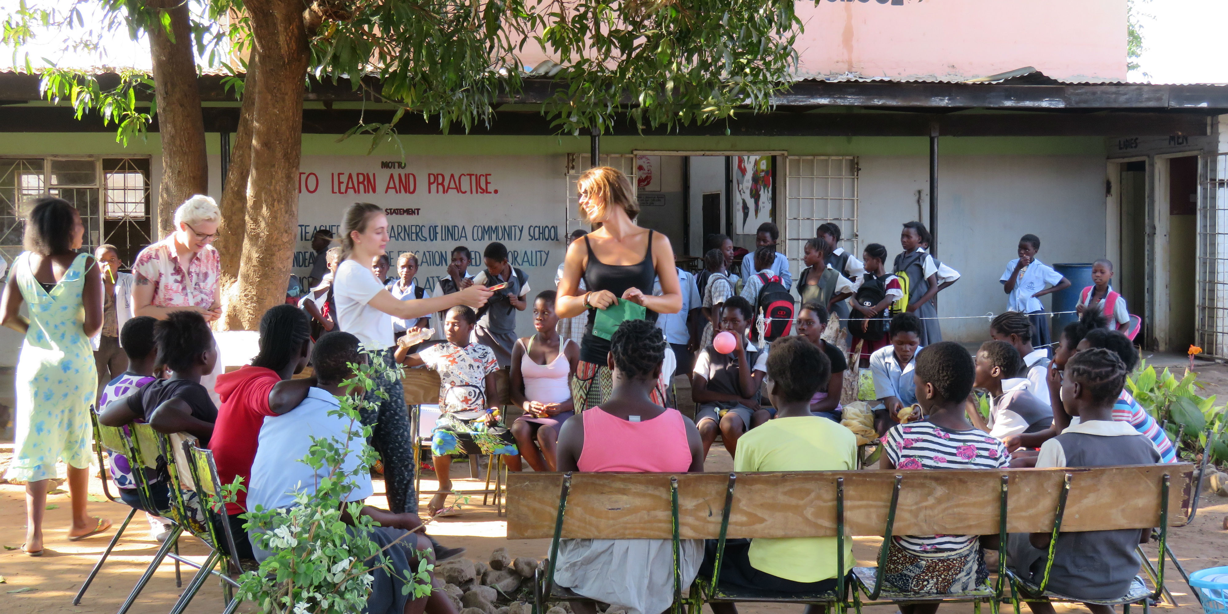 Participants take part in volunteer opportunities in Zambia.