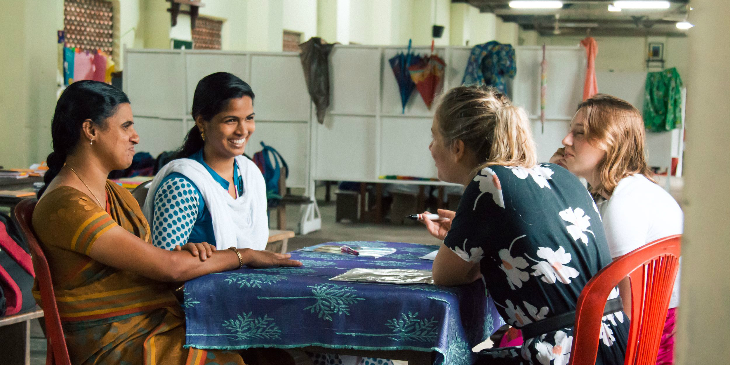 GVI participants engage with local women as part of a women's empowerment program.