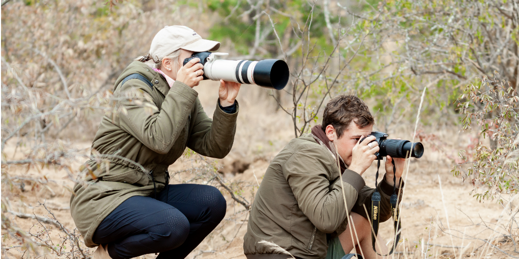 wildlife conservationists taking photographs in the field