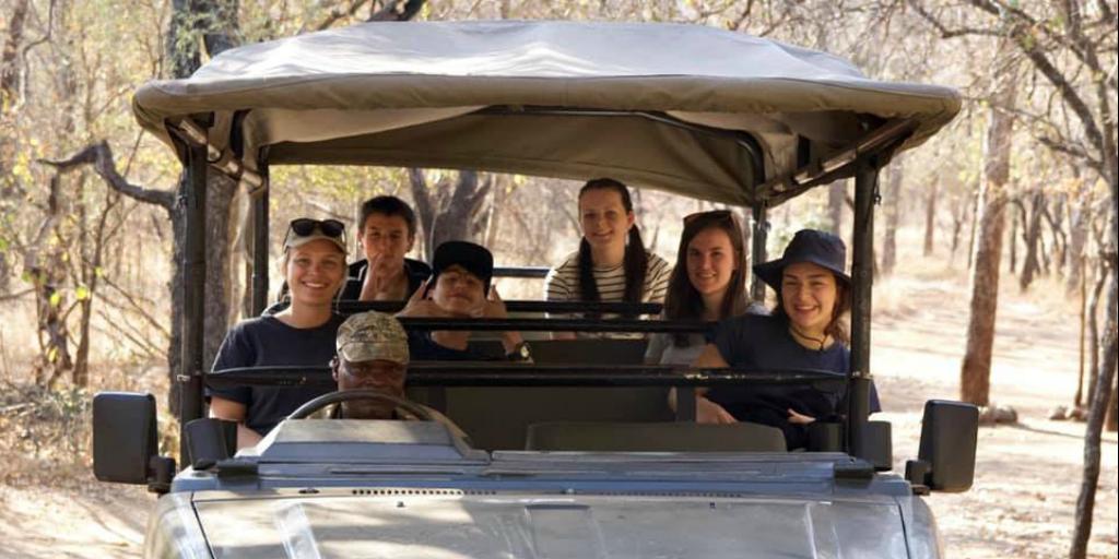 GVI under-18 volunteers in a safari vehicle in South Africa