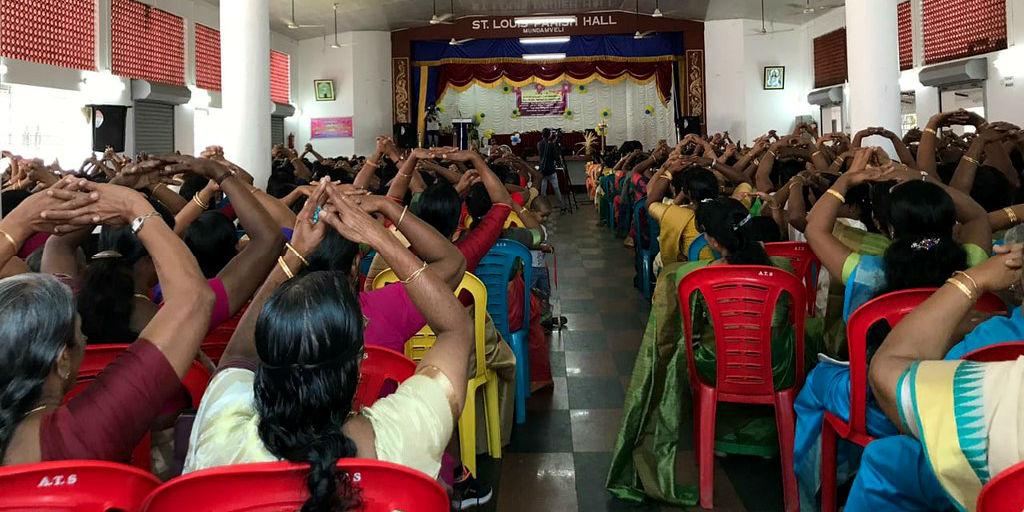 Women in India attend a talk.