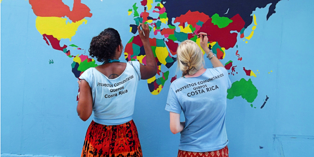The volunteers of GVI enhance their painting skills by painting a world map on the wall.