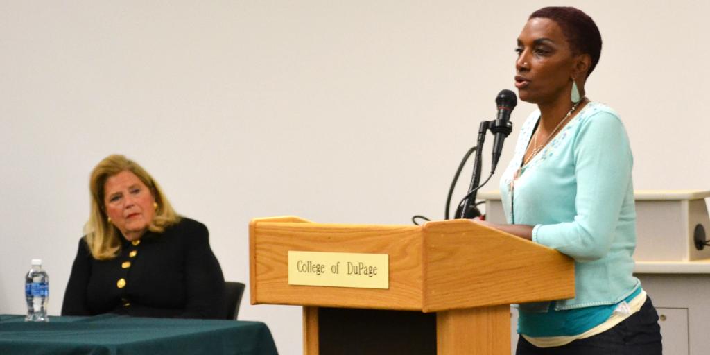 A woman speaks at a human trafficking talk.