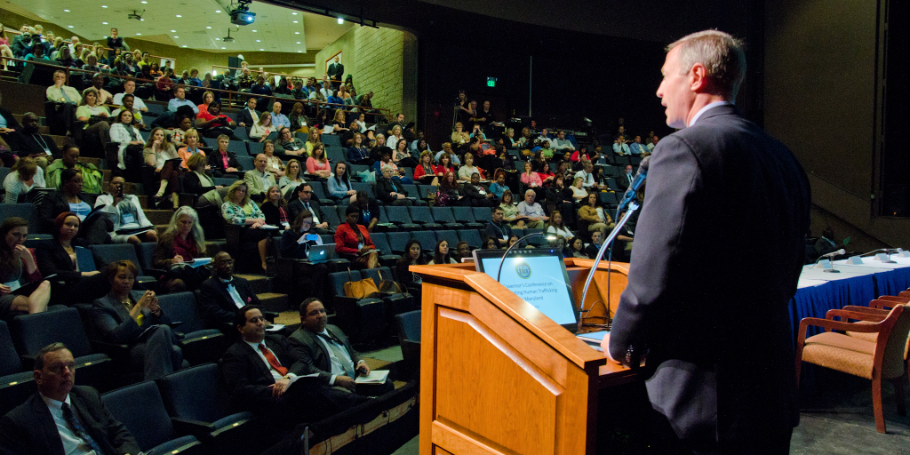 A man speaks at a human trafficking conference.