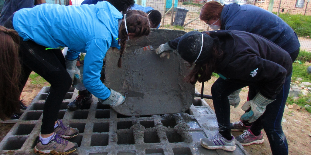 GVI's Cape Town based volunteers contribute to the sustainable community development by building a water tank stand.