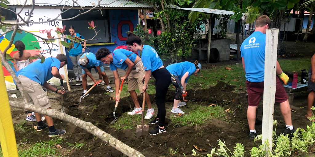 GVI 15 year olds are busy with a community garden project.